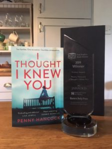 Copy of Novel on table with Award